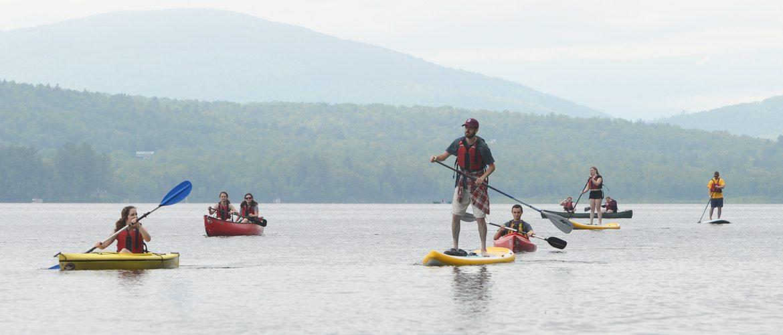 Students kayaking and paddleboarding on Wilson Lake