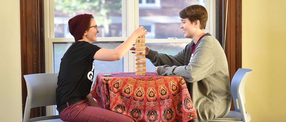 Students playing jinga in a residence hall room