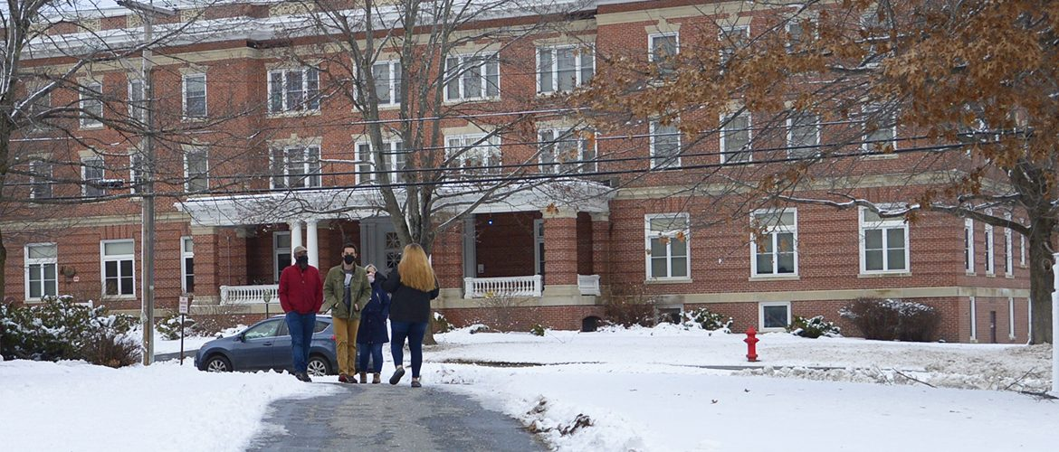 Student and parents walking on campus wearing masks
