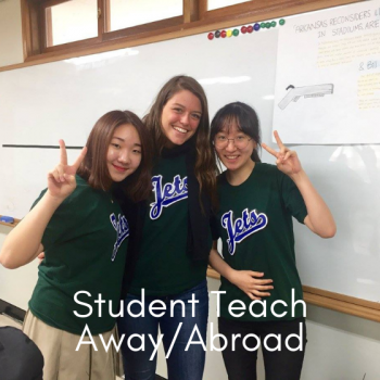 UMF student teacher posing with two young students from South Korea.