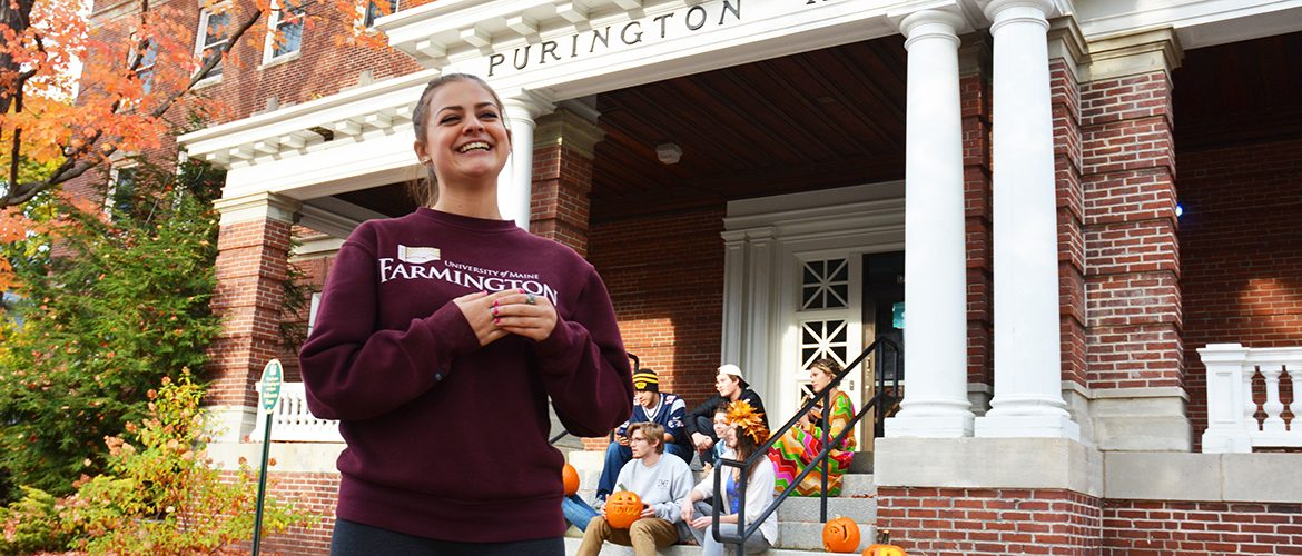Students hanging out outside Purington Hall residence hall