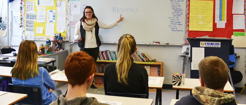 Teacher teaching a class.
