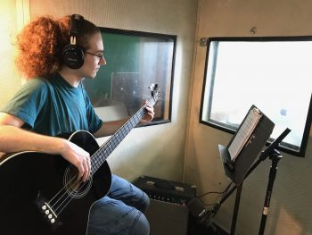 A student practicing recording music.