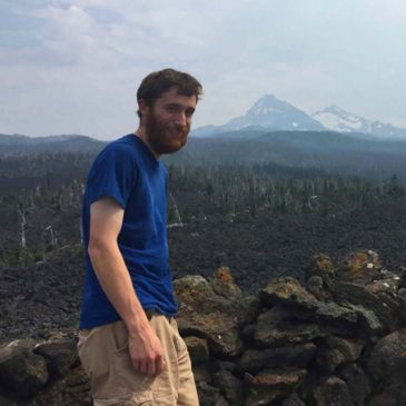 UMF student Bryce Neal at Mckenzie Pass in the Oregon Cascades.