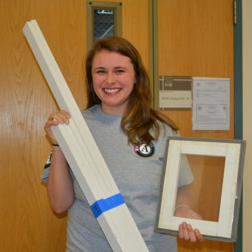 Vanessa Berry, UMF AmeriCorps energy efficiency coordinator, holds miniature sample window insert and pre-cut pieces for window insert build on UMF campus Saturday, Jan. 27 and Monday, Jan. 29