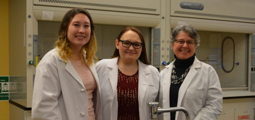 UMF students Brennah O'Connell and Courtney Frost, first participants in UMF Pre-Med Job Shadow program, are joined by Mariella Passarelli, UMF professor of chemistry and director of the pilot program.