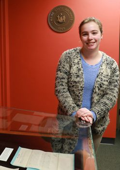 UMF history major Madeline Soucie at her internship at the Maine State Archives.