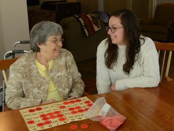 UMF graduating senior Abbie Hartford enjoying a visit with residents at The Pierce House.