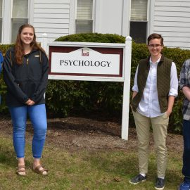 (From left to right) First grads in UMF's Psychology 3+2 program: Charity LaFrance, Haley West, Oak Blaisdell, and Lilyan Ray. Kyla Antonioli is not pictured.