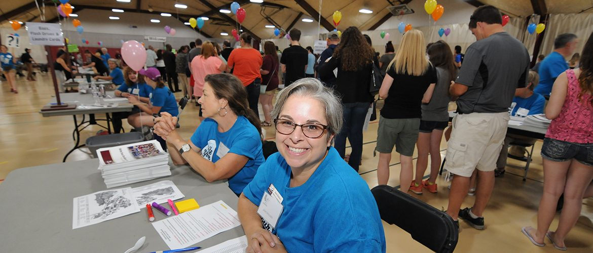 New UMF student having questions answered at Centralized Check-In