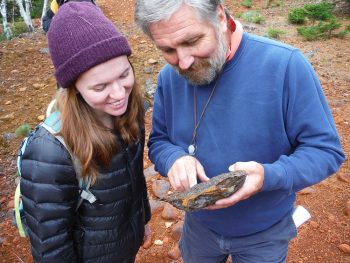 Dr. David Gibson helping former student Kelsey O'Connor with mineral identification.