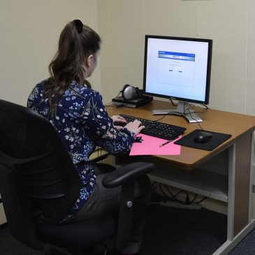 Student at one of twelve supervised testing stations at UMF Testing Services facility.