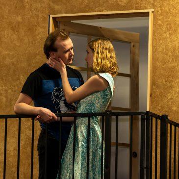 UMF student actors Eli Mowry (Kennebunc) and Audrey Bradbury (Eastport) profess their love as Romeo and Juliet in Shakespeare's famous balcony scene.