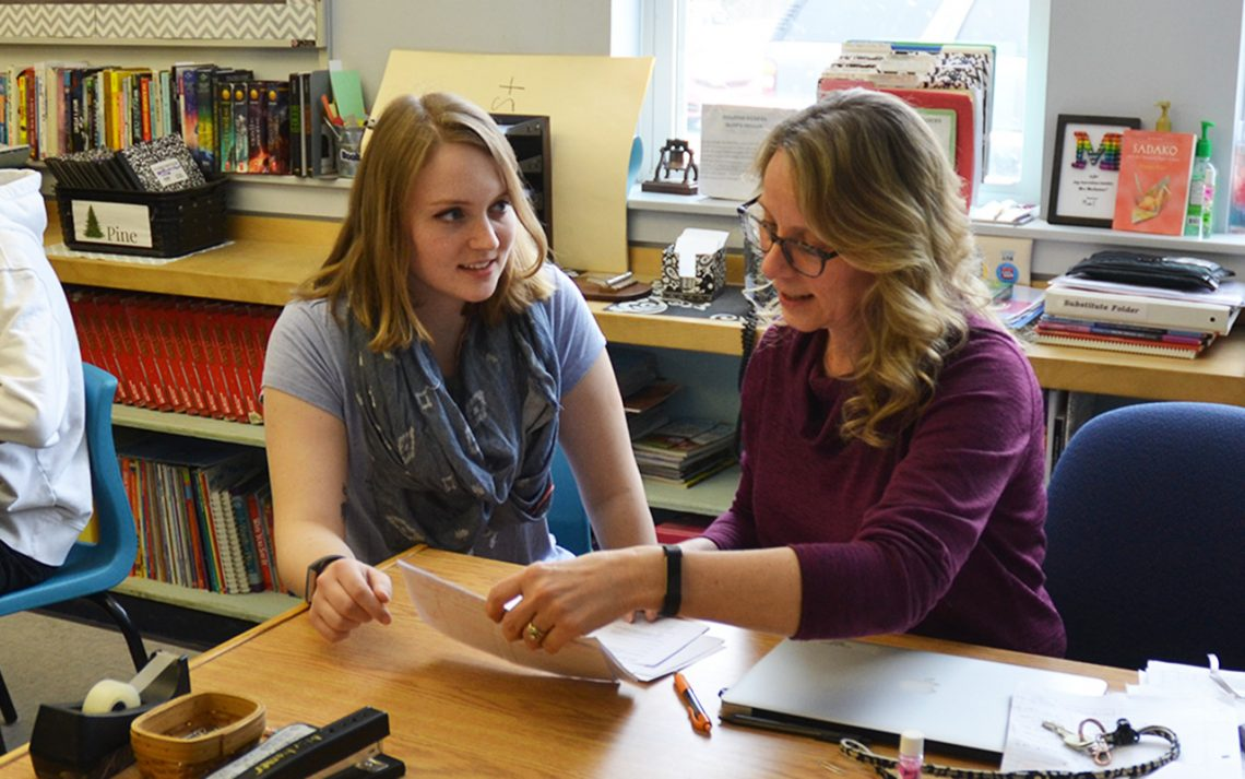 (Left to right) Maggie Pomerleau, UMF senior majoring in secondary education, working at Mt. Blue Middle School with Denise Mochamer, mentor teacher, prior to remote learning directive.