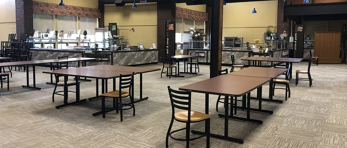 Image of socially distanced dining tables in UMF's South Dining Hall