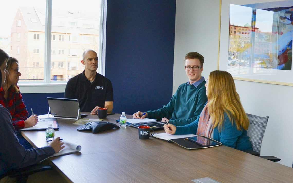 Early this spring, Daniel Mickiewicz, (second from right) UMF Actuarial Science student intern, learned more about EPIC Retirement Plan Services and its internship opportunities from Matt Pine, (center) director of retirement plan consulting, and other EPIC employees.(from left) Justin Toporcer, Kelsey Alley and Ingrid Libby.