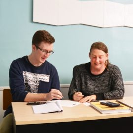"""Daniel Mickiewicz, (left) UMF Actuarial Science student says, """"Professor Koban (right) is a wonderful advocate for students. She's our number one resource."""""""