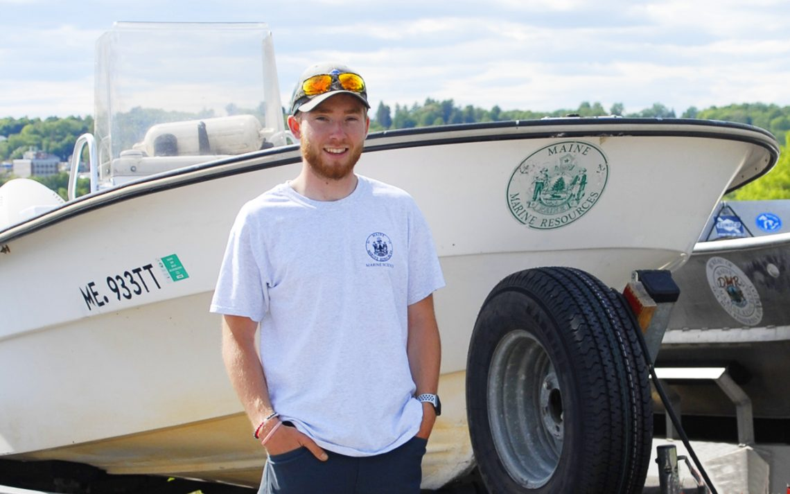 Thomas Wing, an Earth and Environmental Science graduate from the University of Maine at Farmington at his job with the Maine Department of Marine Resources.