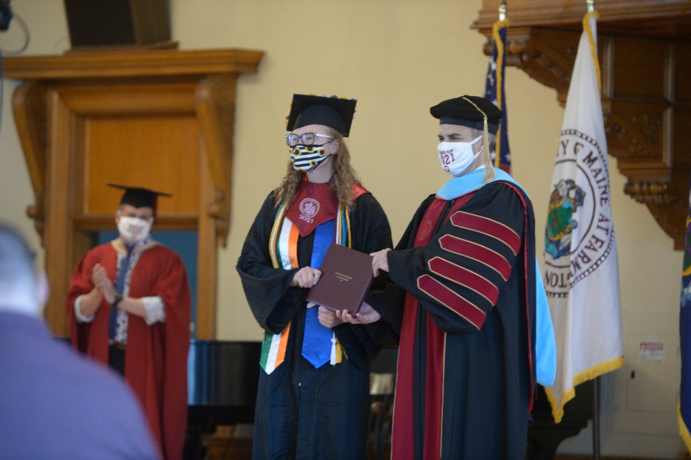 UMF President Edward Serna conferring degrees to the Class of 2021