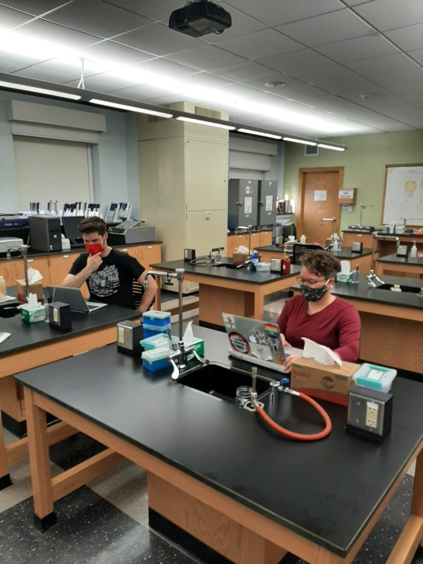 UMF students Andrew Wilcox (left) and Anyssa Phaneuf (right) conduct an analysis by computer in the Ricker Hall 220 laboratory.