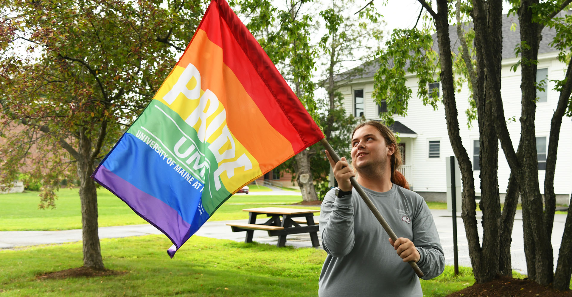 Student holding a Pride flag